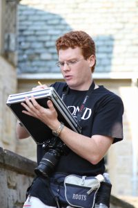 A Script Supervisor hard at work on a film set